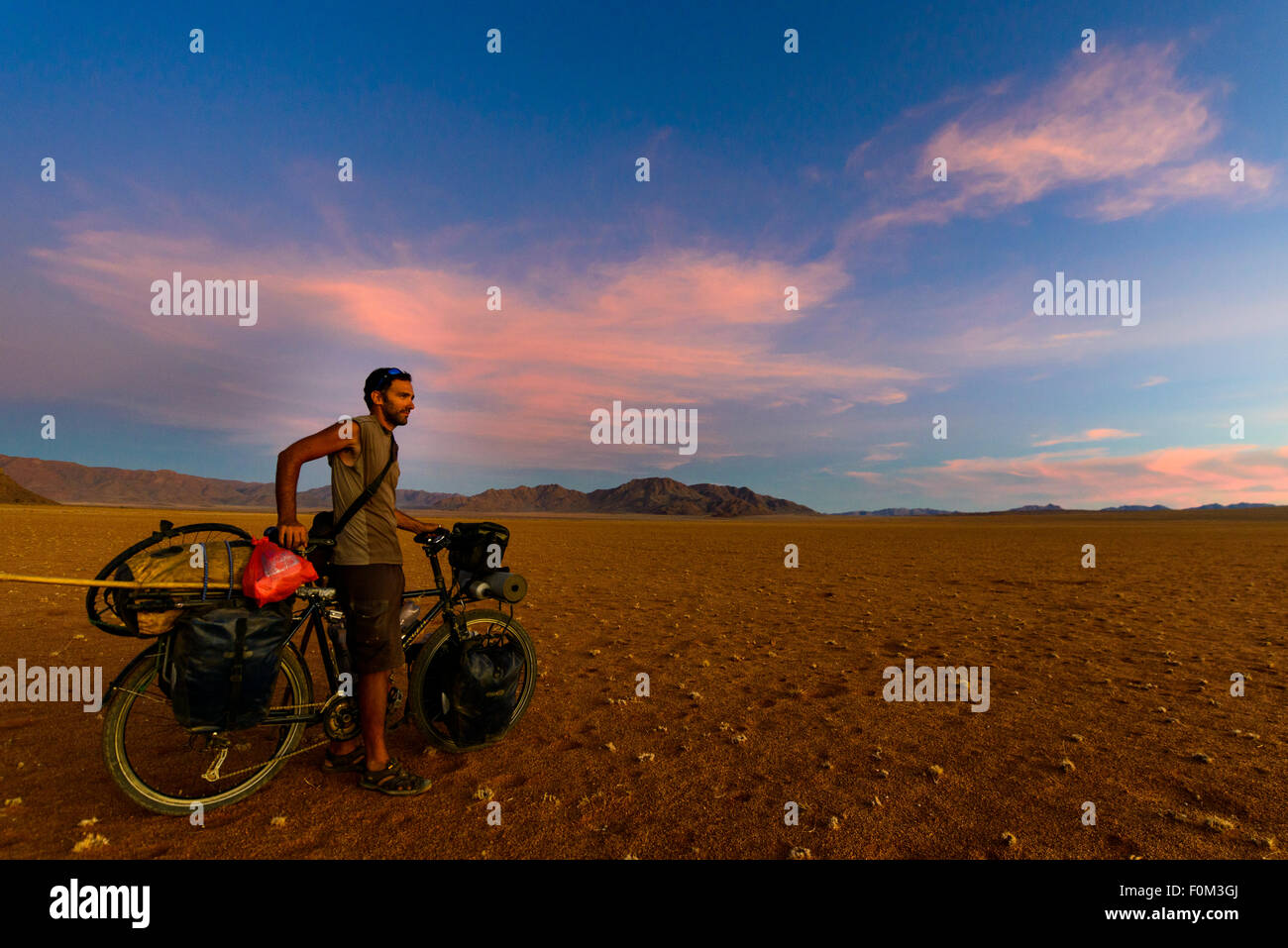 Cycling in the Namib desert, Namibia, Africa Stock Photo