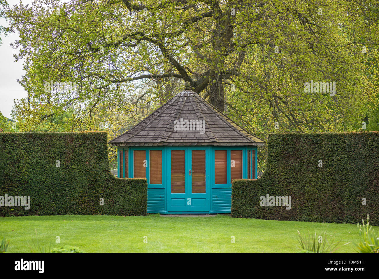 wooden summer house in a garden - Stock Image