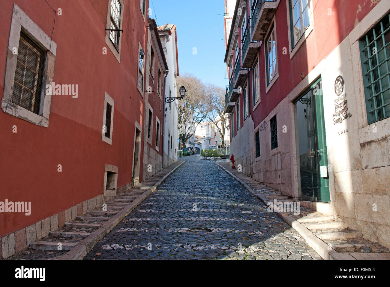 Typical small tidy road in the old part of city Lisbon and museum the Fondation Ricardo do Espirito Santo Silva, - Stock Image
