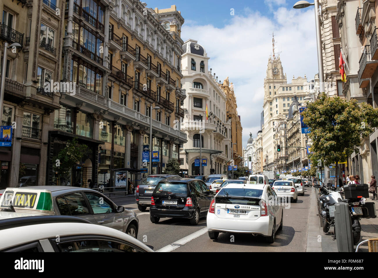 Busy traffic on the Gran Vía, in the Spanish capital city of Madrid. - Stock Image