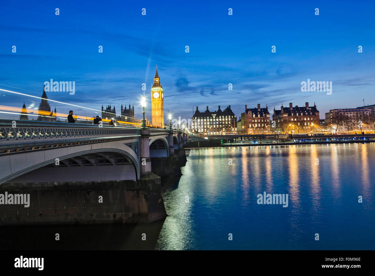 Westminster Bridge and the Neo-gothic Houses of Parliament by Charles Barry and Augustus Pugin, at night time - Stock Image