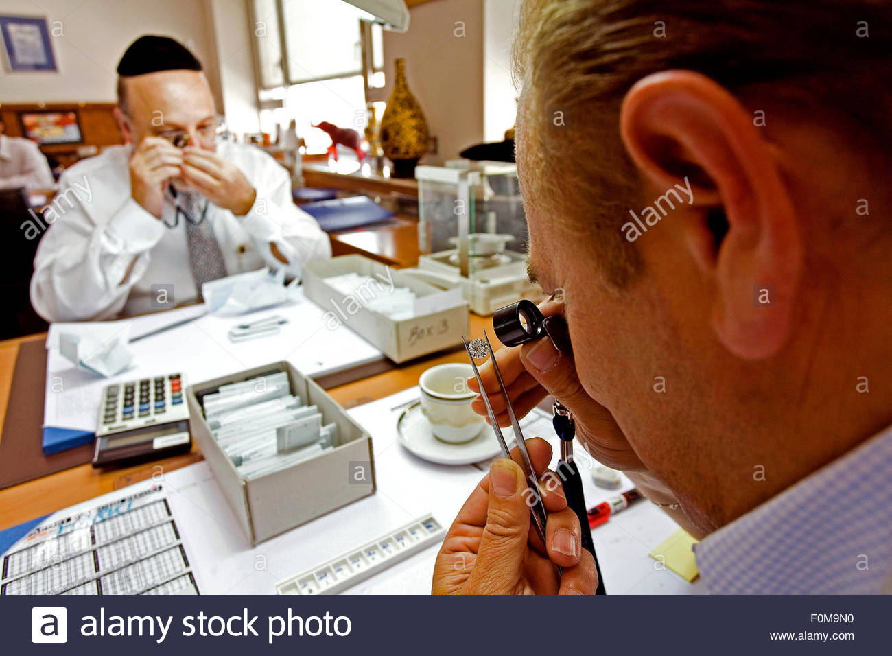Antwerp, Buying diamonds, The Diamond merchants are selecting the production, The Eurostar Diamond Trader is owned - Stock Image