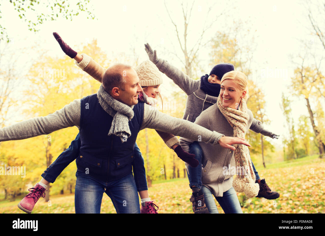 happy family having fun in autumn park - Stock Image