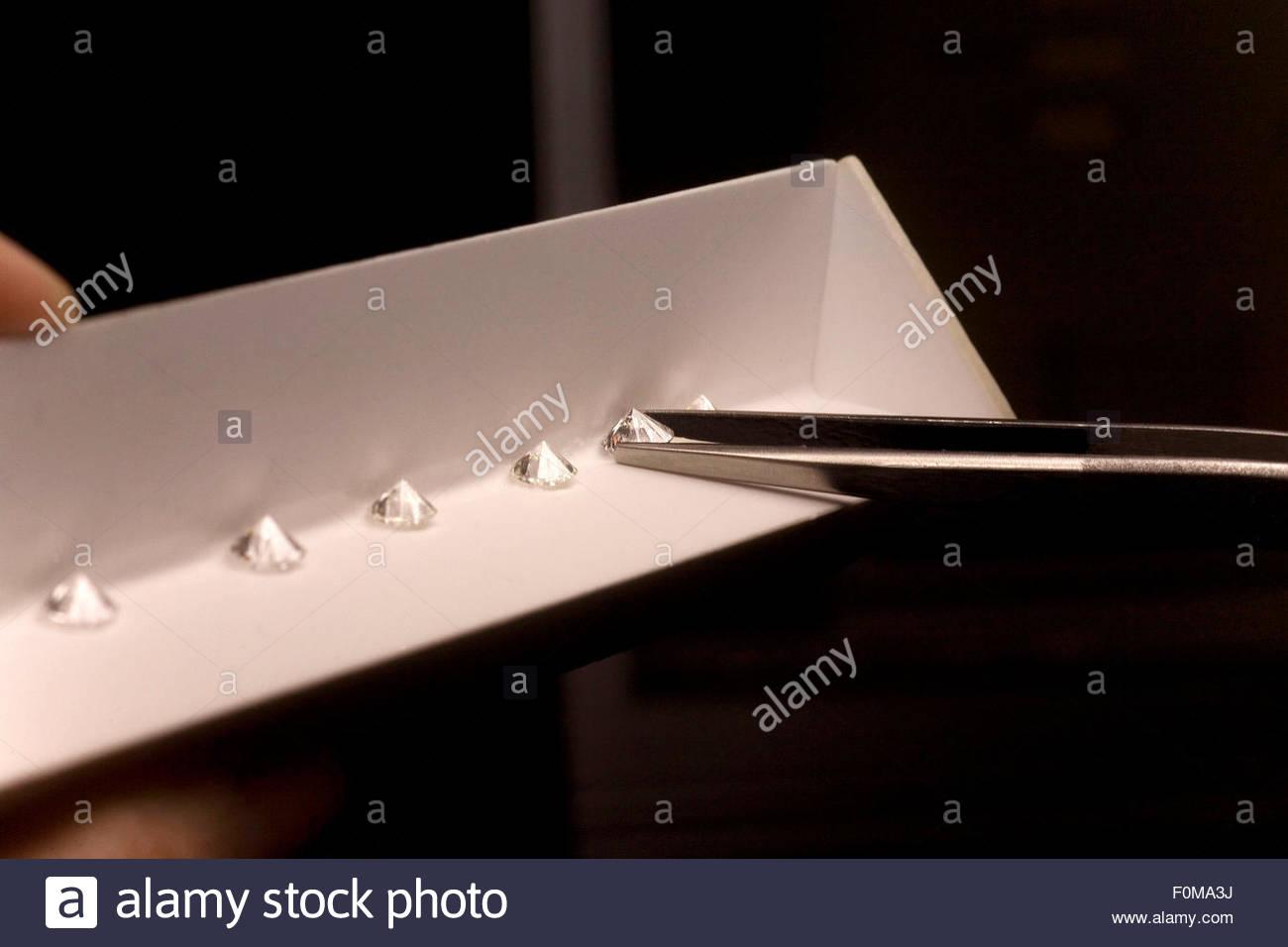 Studying the colour of the Diamonds, Antwerp World Diamond Center, Antwerp. - Stock Image