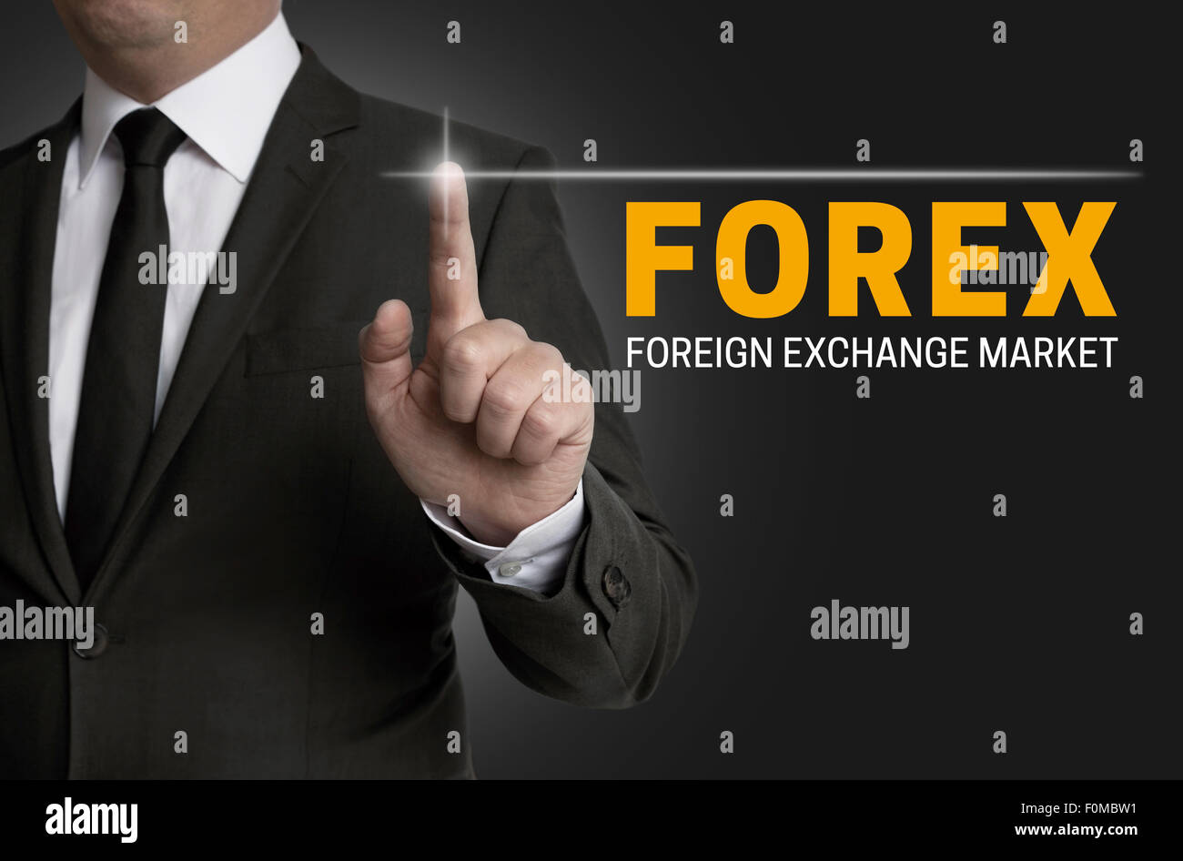 Forex touchscreen is operated by businessman. - Stock Image