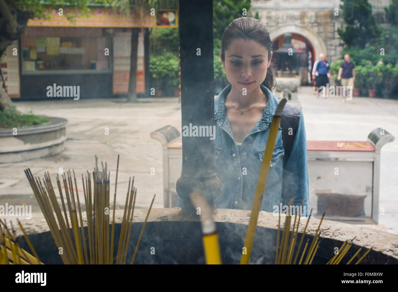 Burning incense at  Po Lin Monastery, Lantau Island, Hong Kong - Stock Image