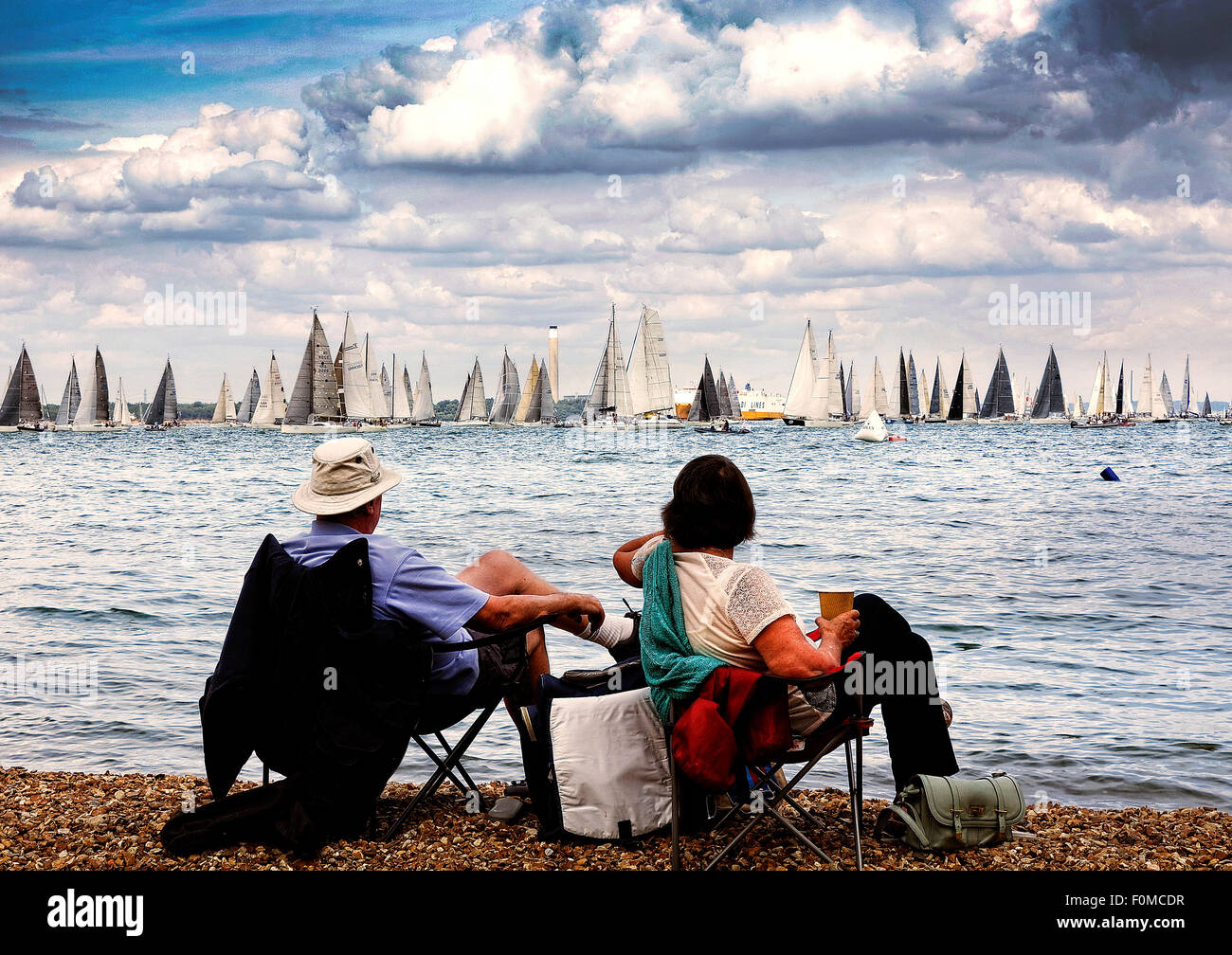The start of the Fastnet 2015 race is closely watched by relaxing tourists to the Isle of Wight - Stock Image