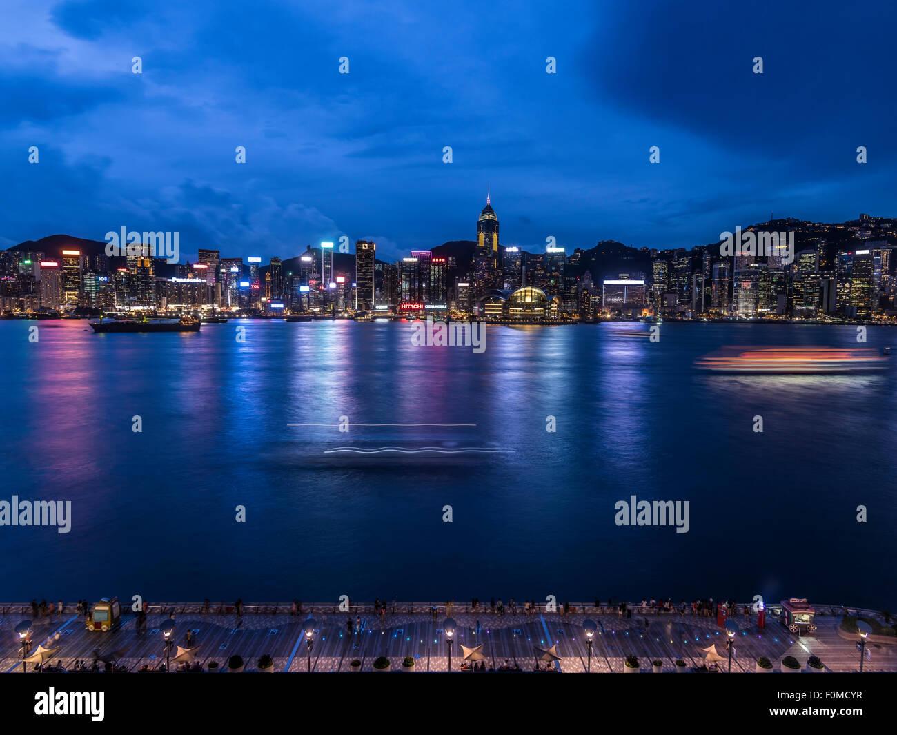 Hong Kong skyline at dusk from the iconic Intercontinental Hotel,Tsim Sha Tsui, Hong Kong - Stock Image