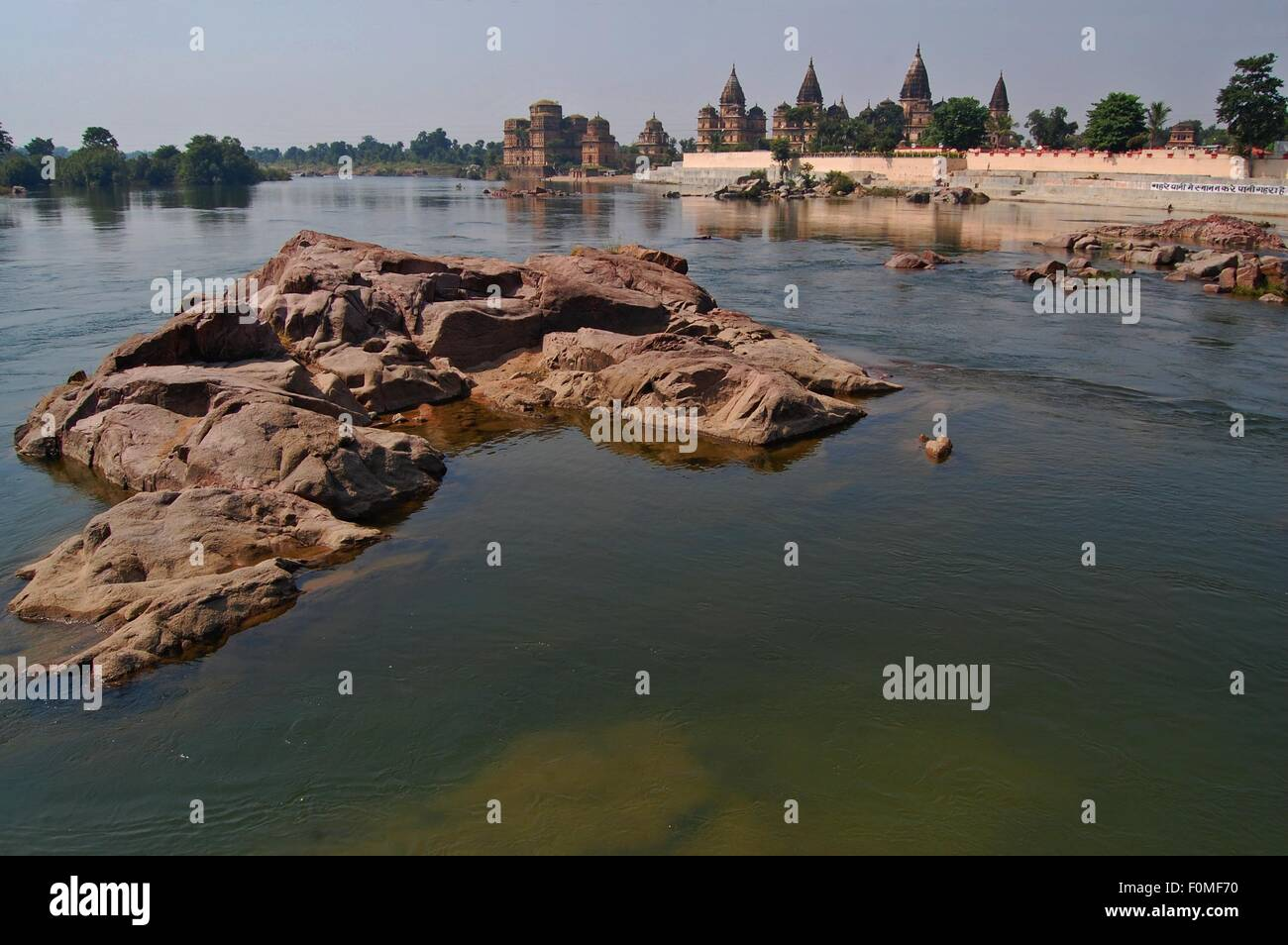 Chhatris or cenotaphs near the ghats on the River Betwa in Orchha India - Stock Image