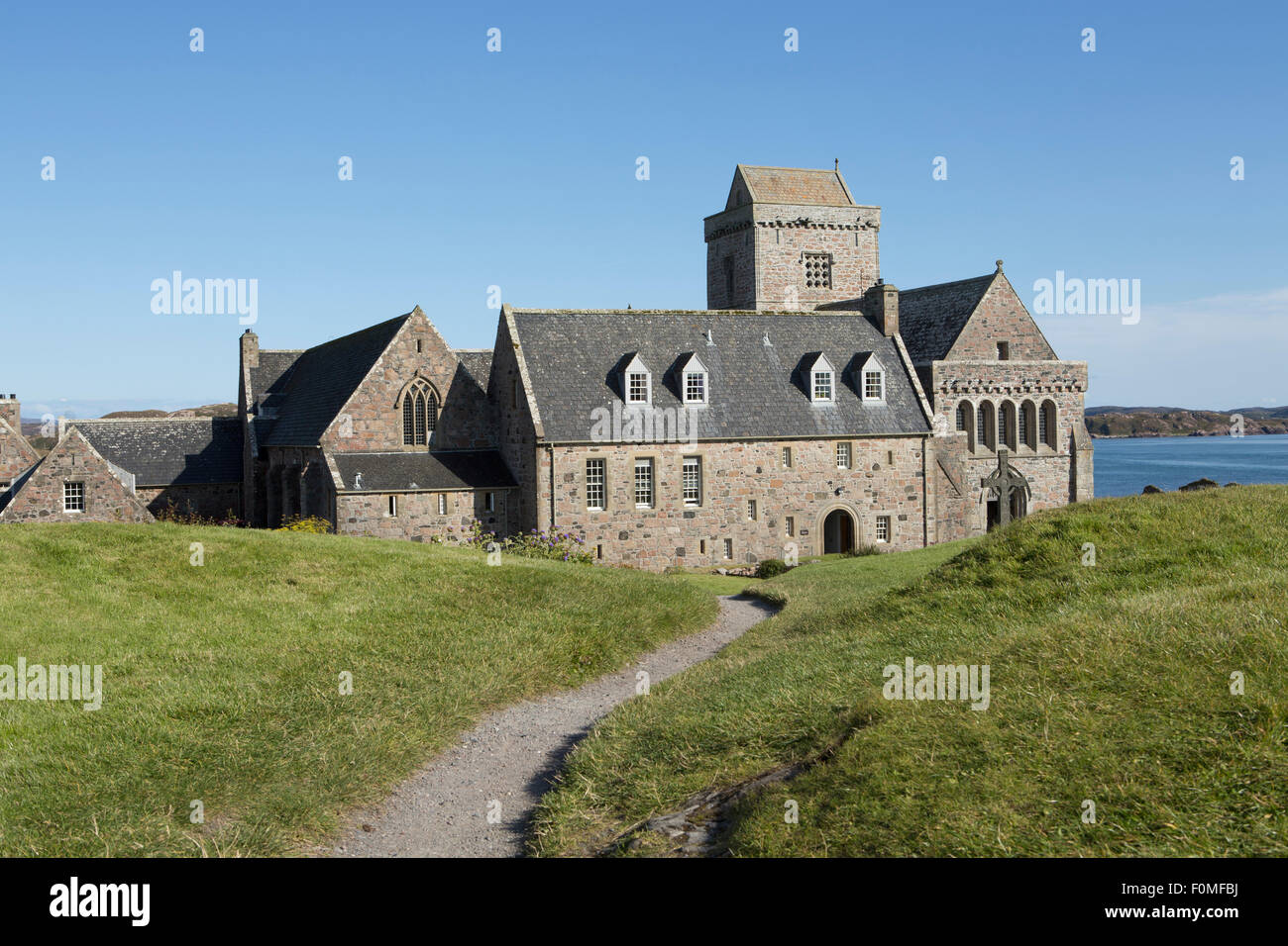 Iona Abbey, one of the oldest sites of Christian worship in Europe and the burial place of Macbeth, founded by Columba - Stock Image