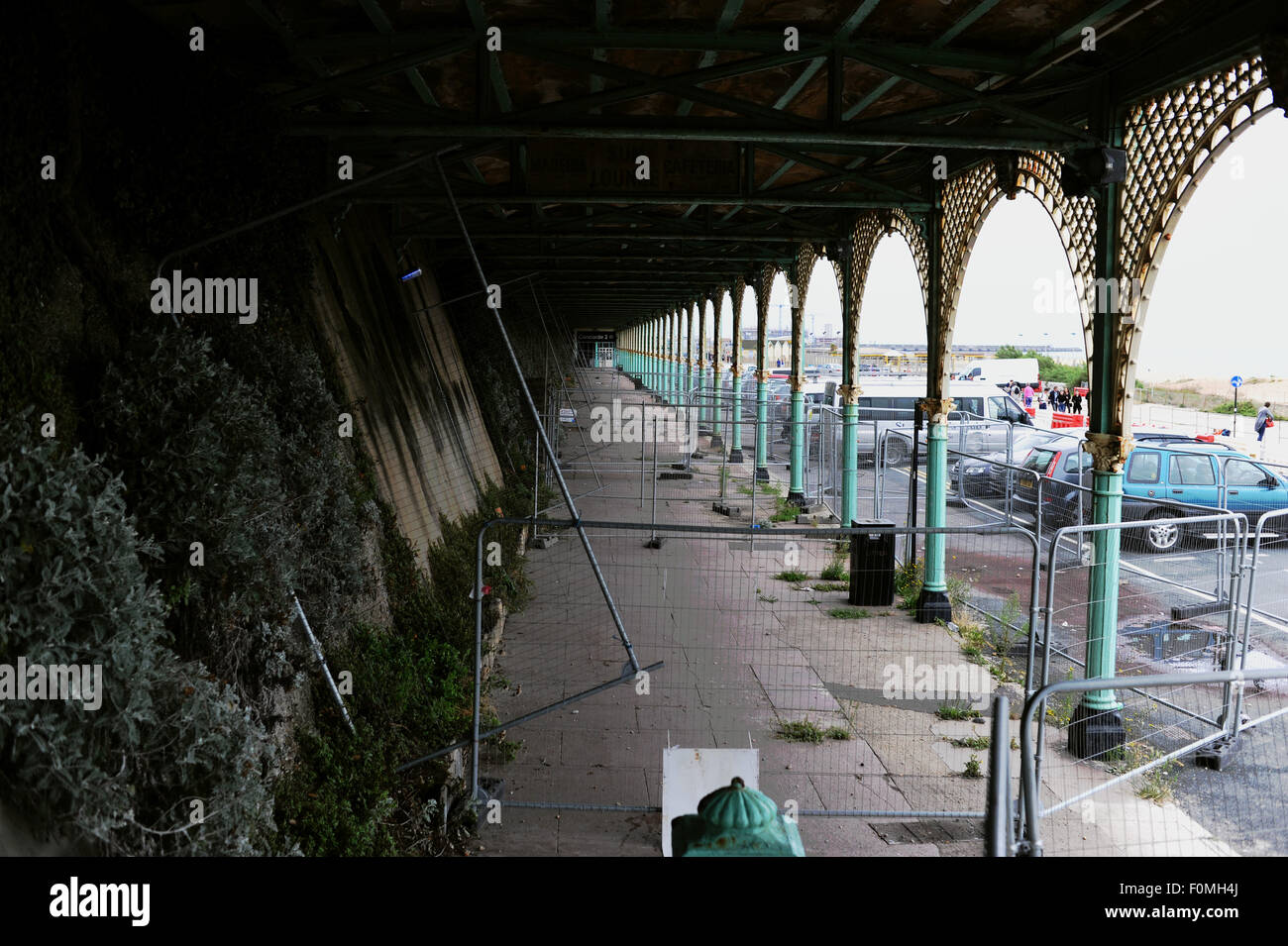 Brighton, UK. 18th August, 2015. A view under the crumbling Brighton seafront arches along Madeira Drive which have - Stock Image