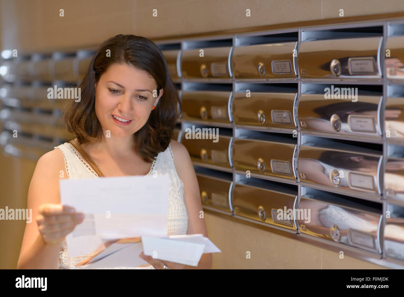 Beautiful woman reading correspondence - Stock Image
