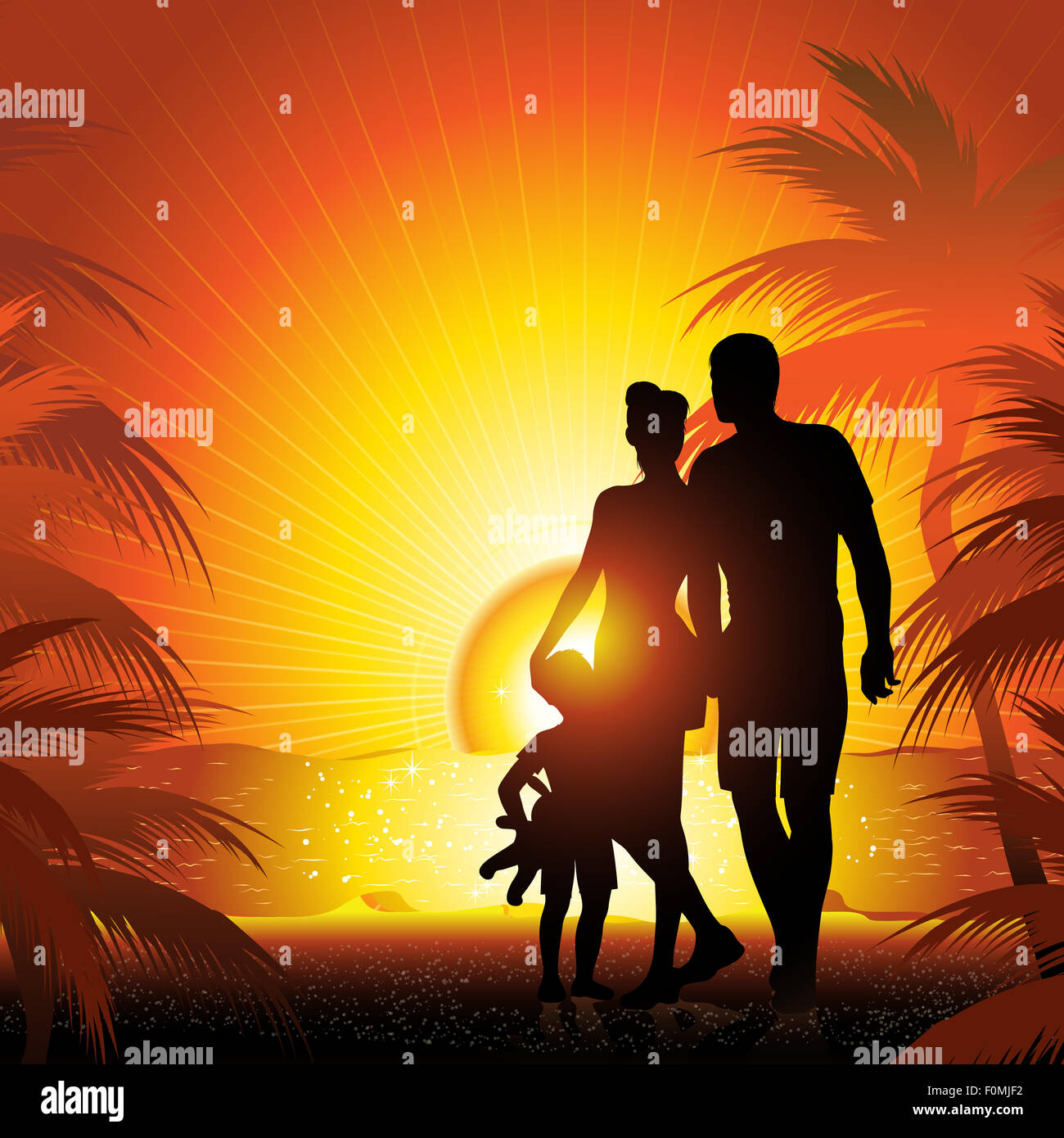 family silhouette on the beach with sunset Stock Photo