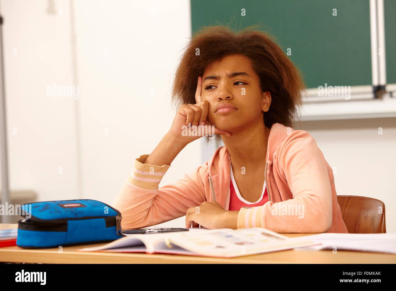 Thinking Girl in school - Stock Image