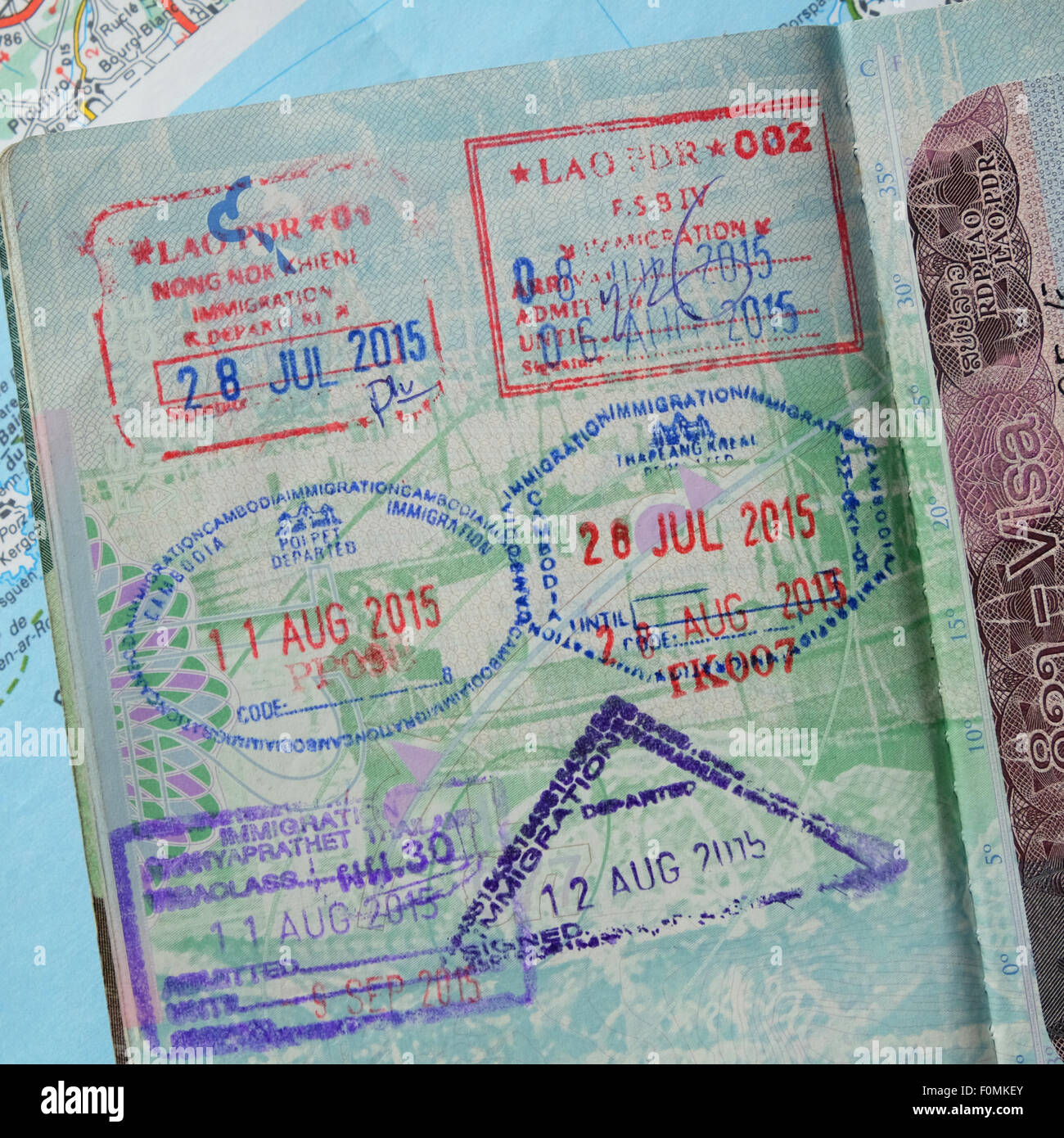 Travel stamps in a passport from countries in South East Asia dated 2015 - Stock Image