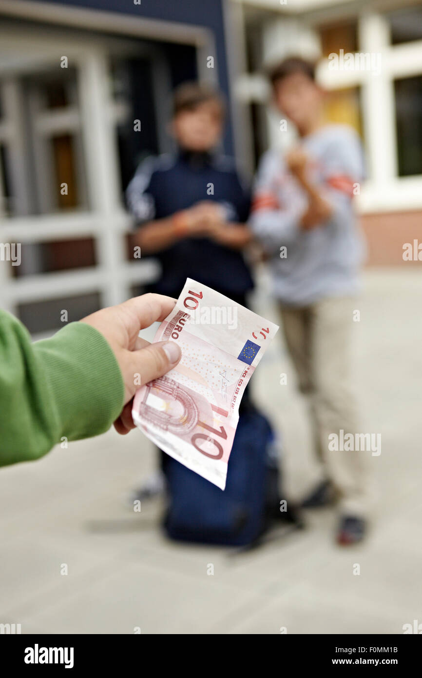 Extortion on the playground Stock Photo