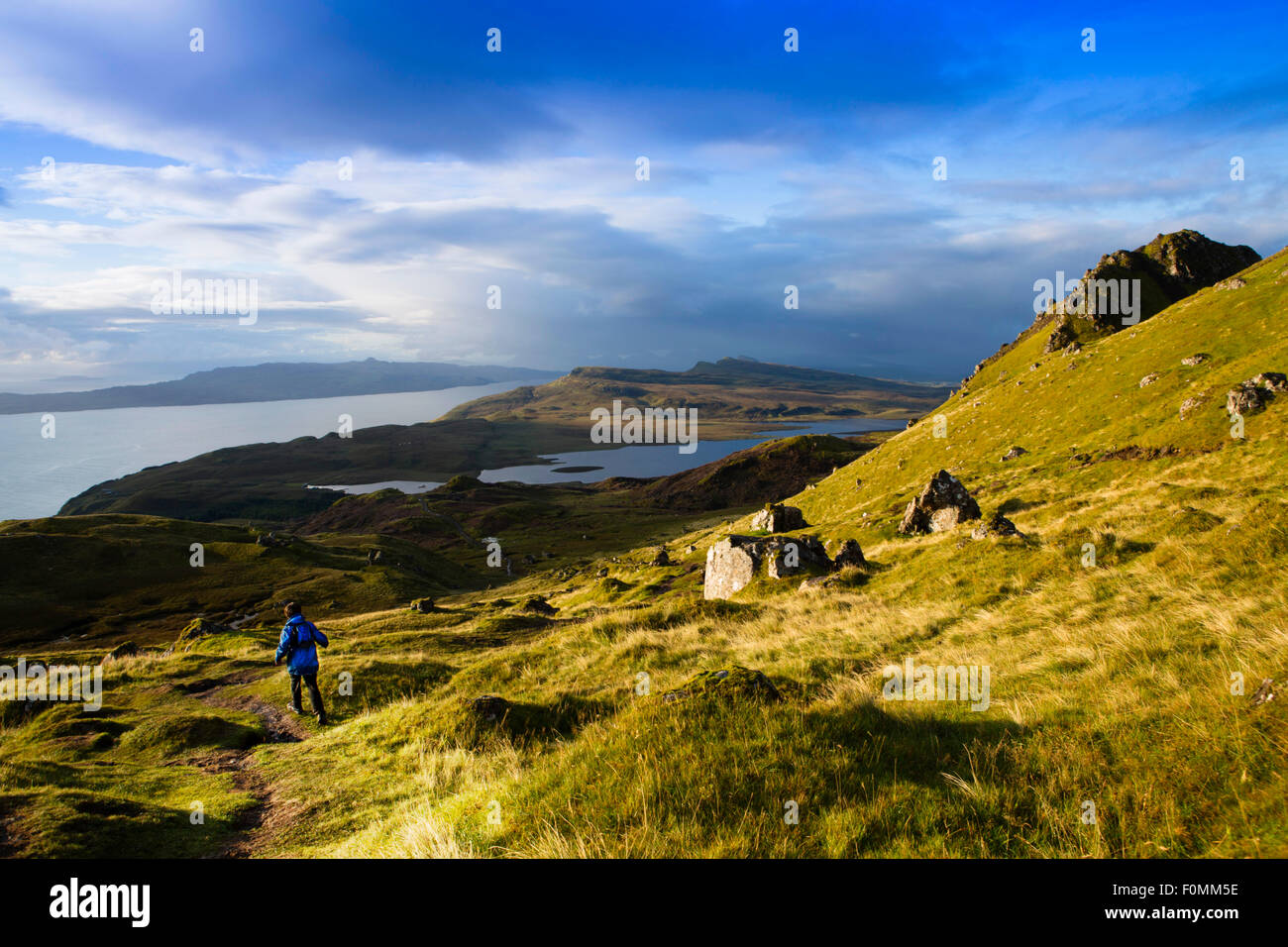 Scotland, Hebrides, Skye, a boy hiking on a on the Storr trail in Trotternish - Stock Image