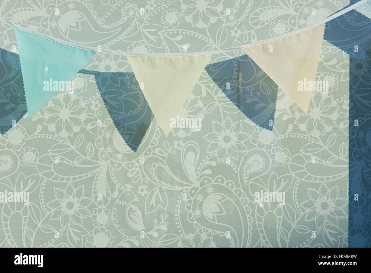 Bunting hanging in shop window - Stock Image