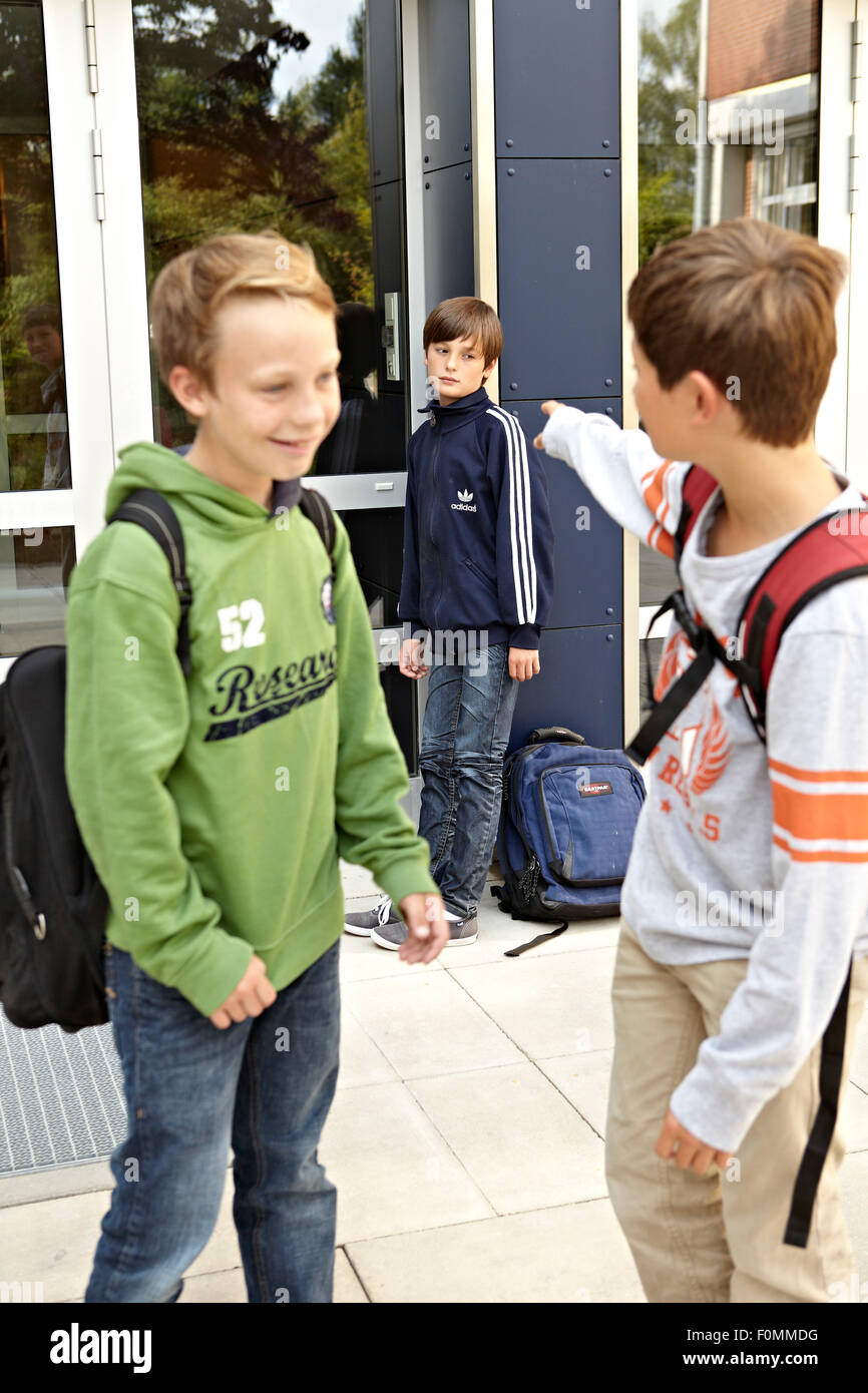 Schoolboy being bullied - Stock Image