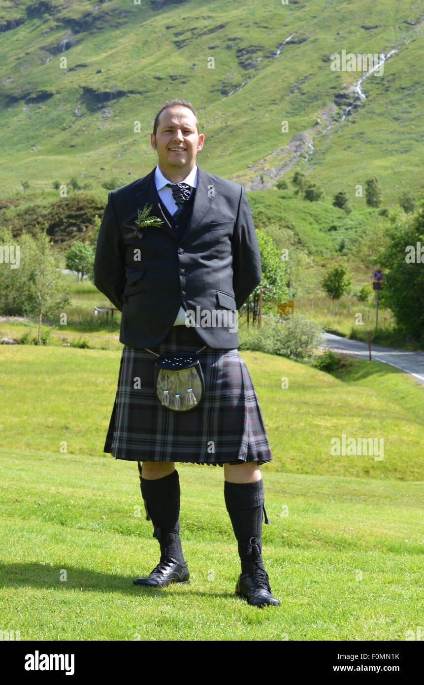 man in kilt in Glencoe Scotland - Stock Image