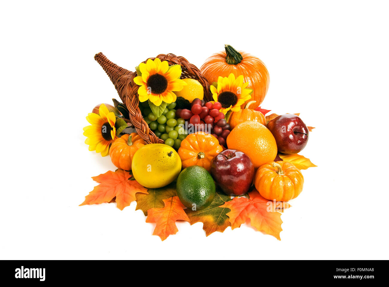 Beautiful and brightly colored fall cornucopia centerpiece arrangement - Stock Image