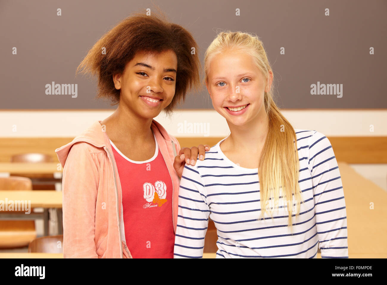 Two girls in school - Stock Image