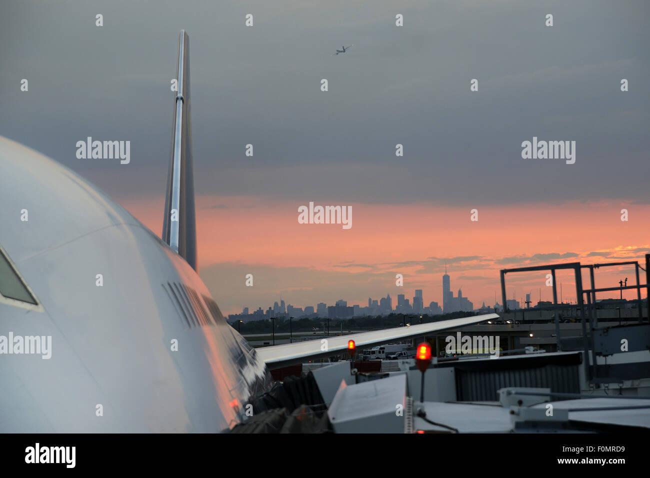 Civil aircraft maintenance and boarding at JFK airport - Stock Image