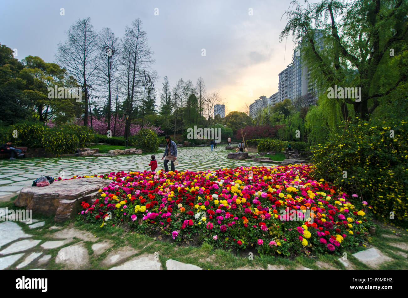 A family enjoying in one of the parks in Shanghai. - Stock Image