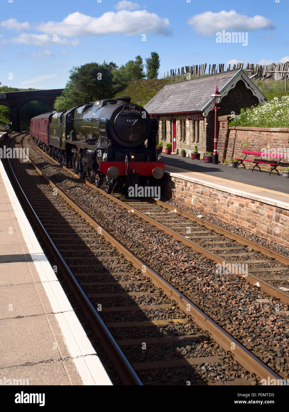 The Fellsman Hauled by 46115 Scots Guardsman passing Dent Station Dentdale Yorkshire Dales Cumbria England - Stock Image