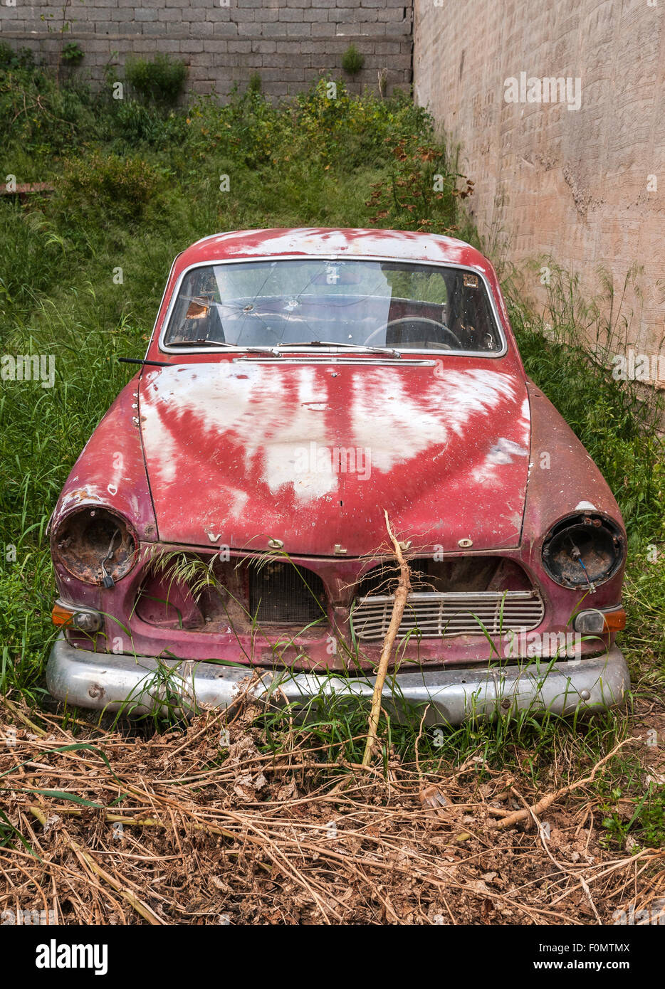 Abandoned car, old Volvo, on vacant plot.  Crete, Greece - Stock Image