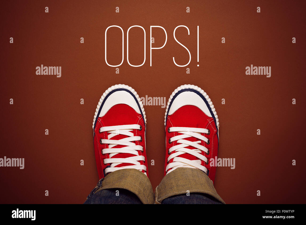 Oops, Young Person MAde a Mistake Concept with Red Sneakers from above, Top View - Stock Image