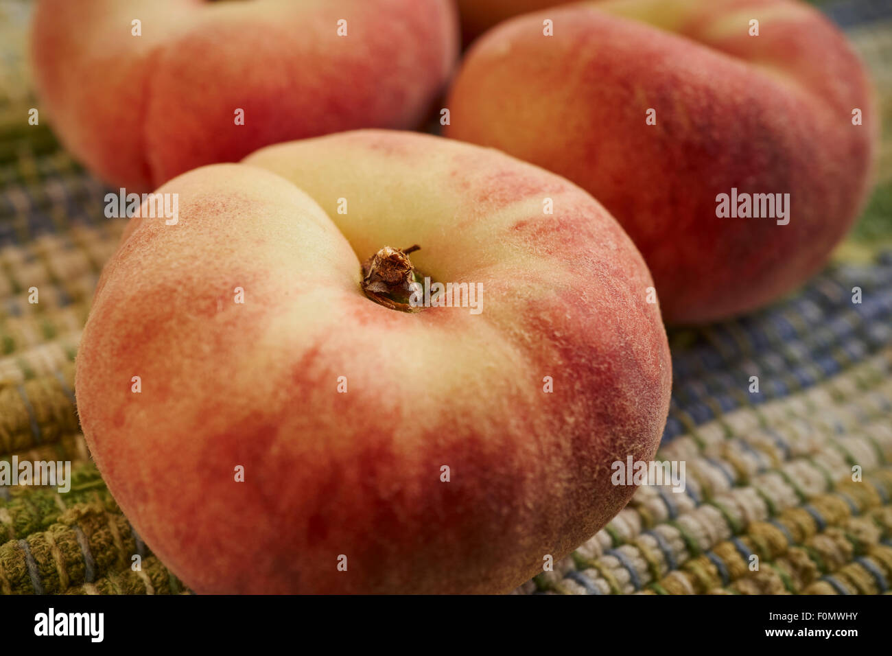 fresh, ripe donut peaches from Lancaster County, Pennsylvania, USA - Stock Image