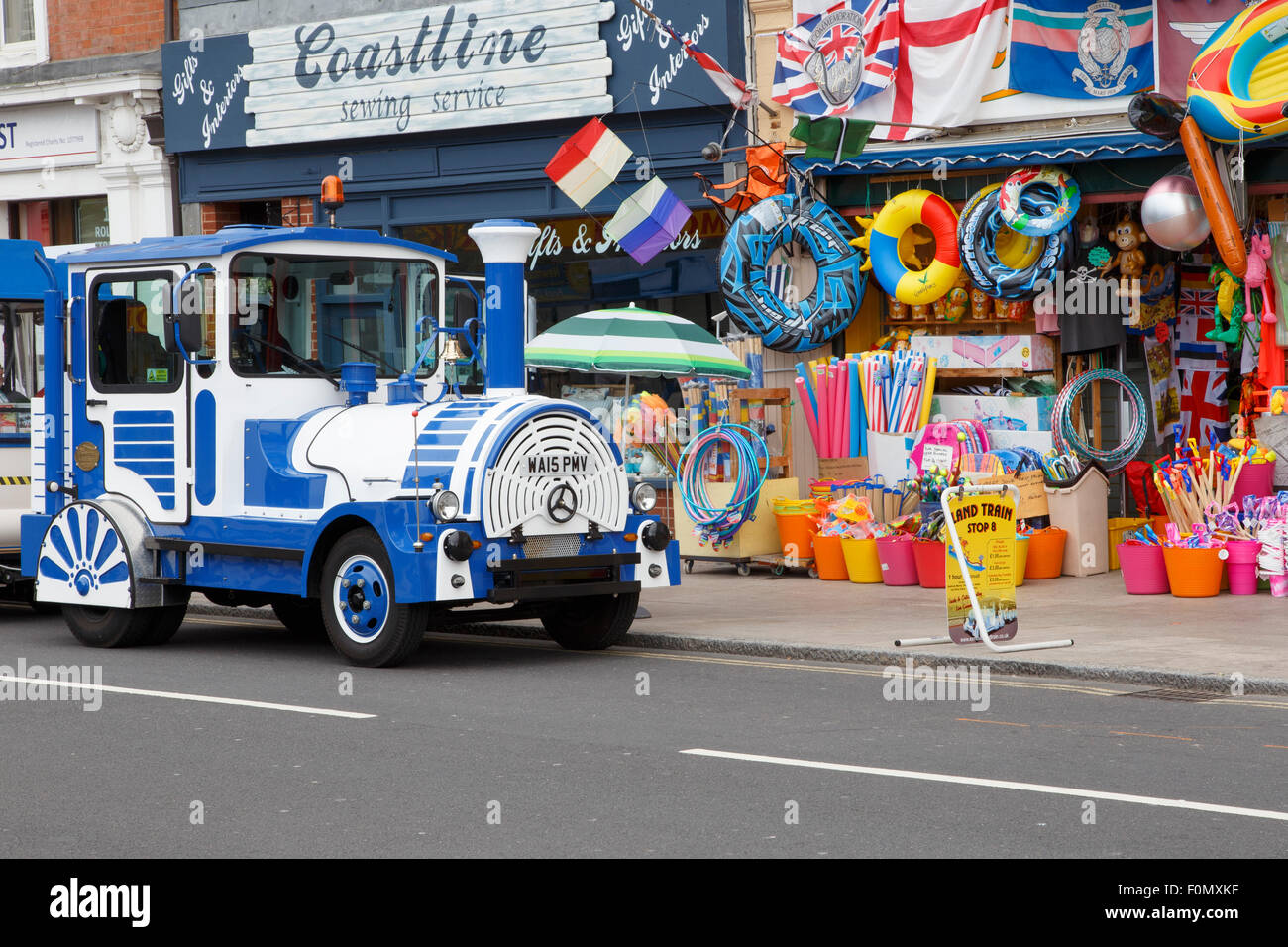 The 'land train' tourist ride in Exmouth, stopping outside a beach shop. Stock Photo