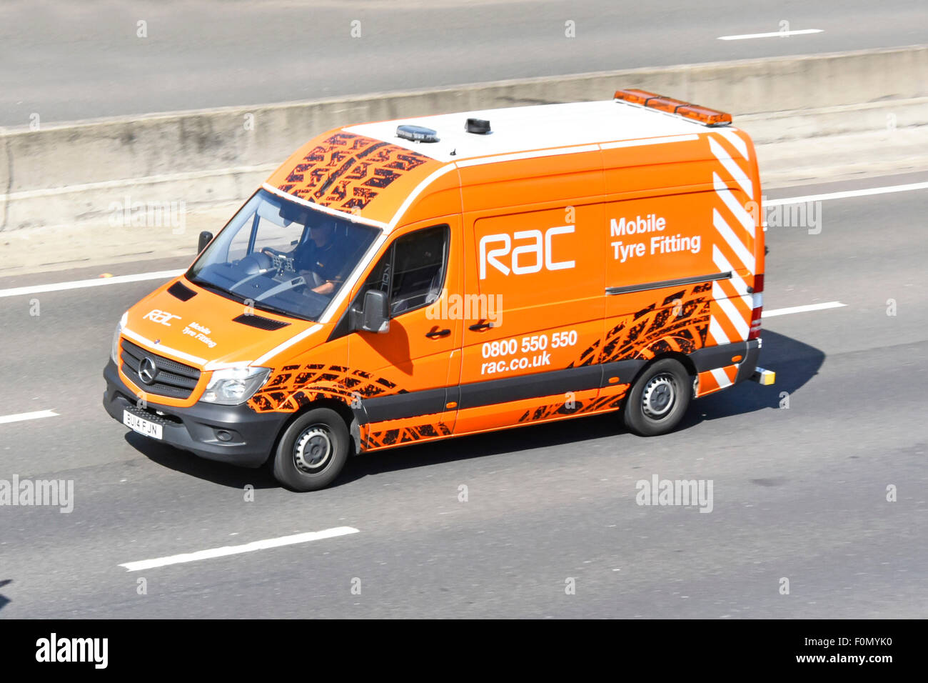 b66da628ed RAC Mobile Tyre Fitting service van driving along UK motorway - Stock Image