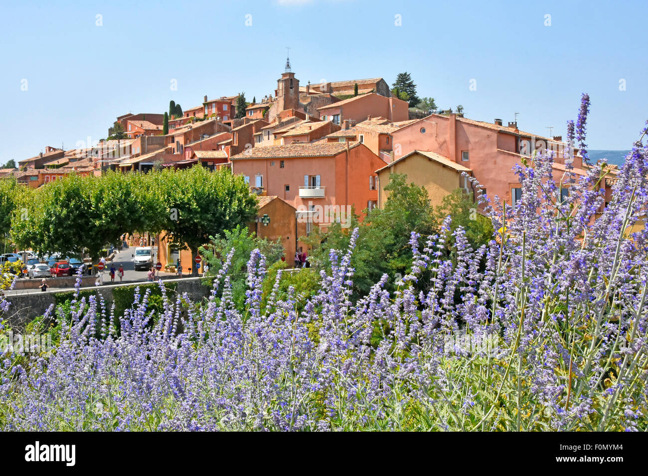 Homes in the touristy hillside commune of Roussillon in the Vaucluse department in Provence southeastern France - Stock Image