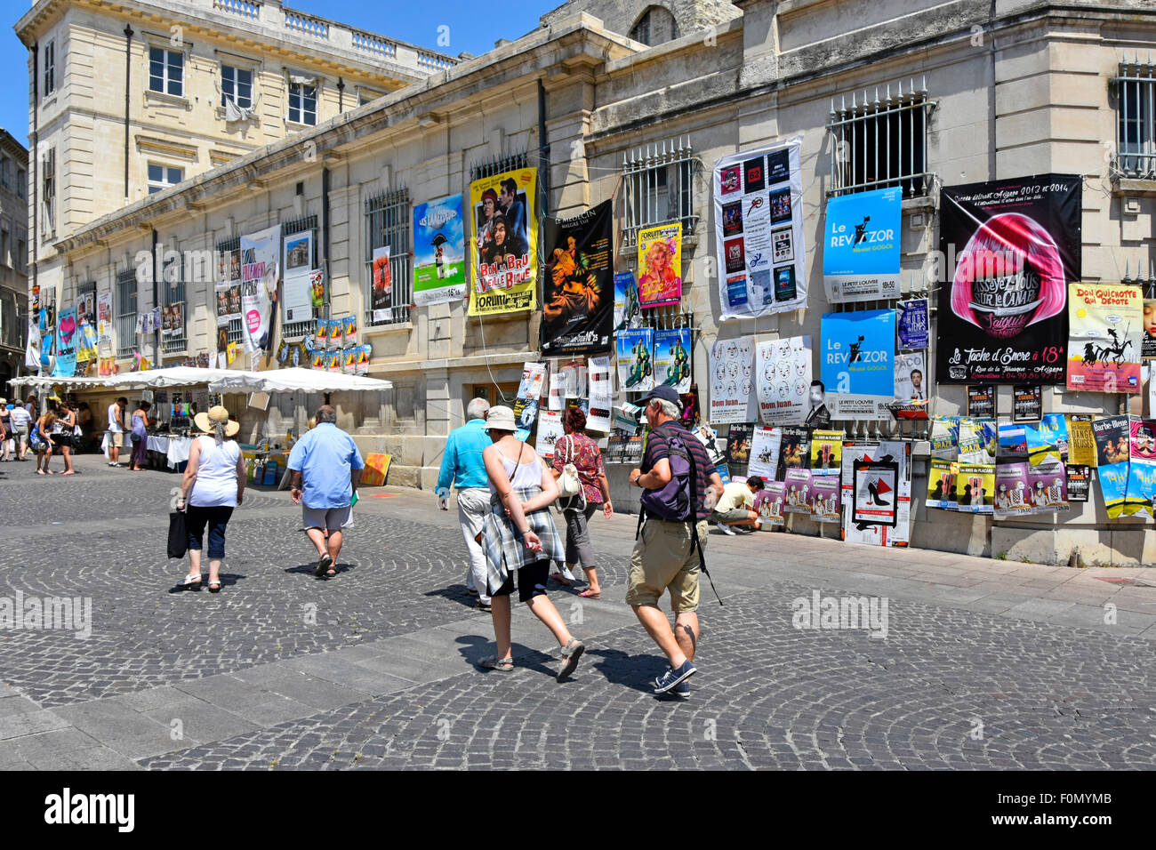 Avignon festival annual July arts festival posters cover the sides of buildings in the city centre Provence South - Stock Image