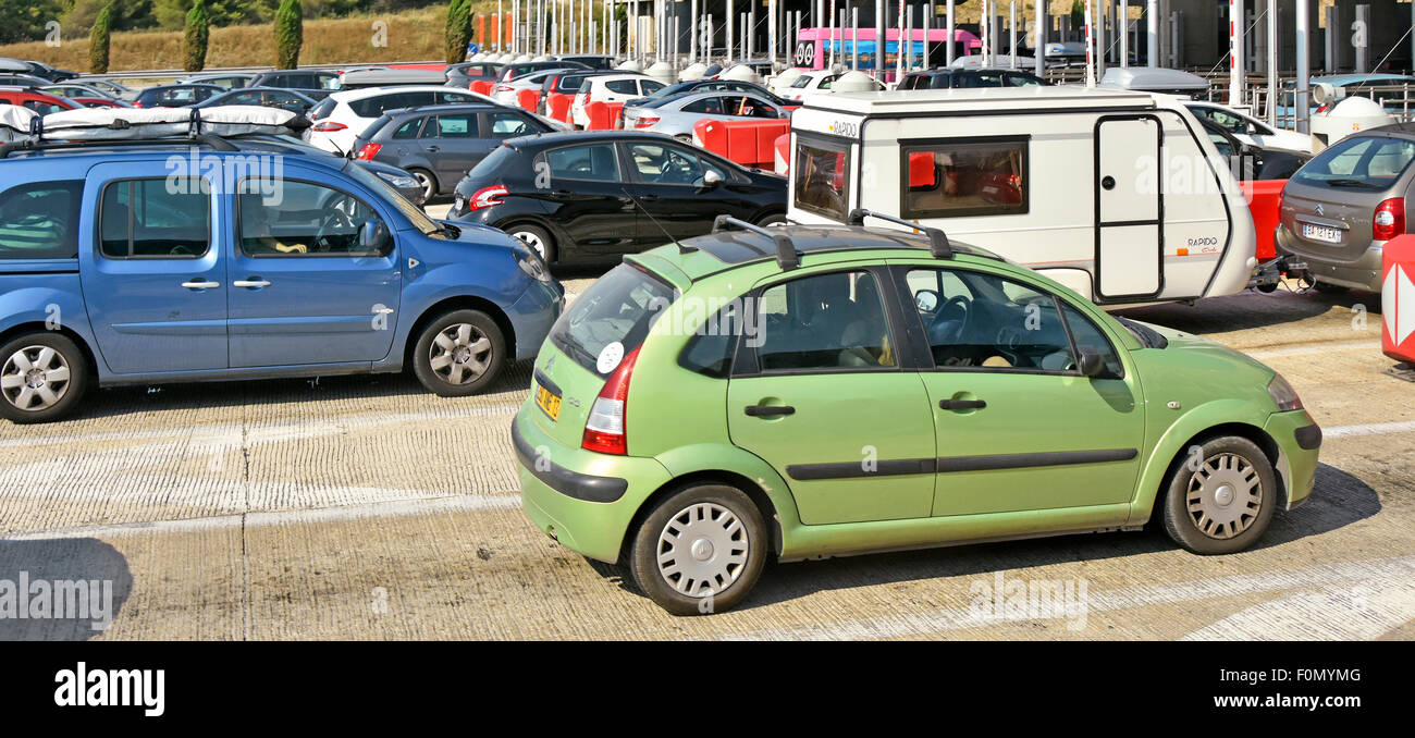 Cars queuing at busy French motorway toll booths in Provence South of France Autoroute - Stock Image