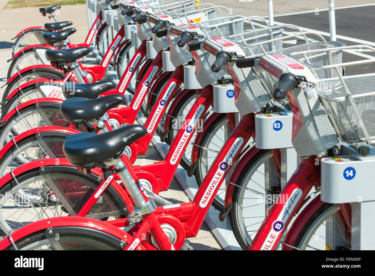 B-cycle bike sharing program bicycles docked at the Cumberland Park B-station in Nashville, Tennessee. - Stock Image