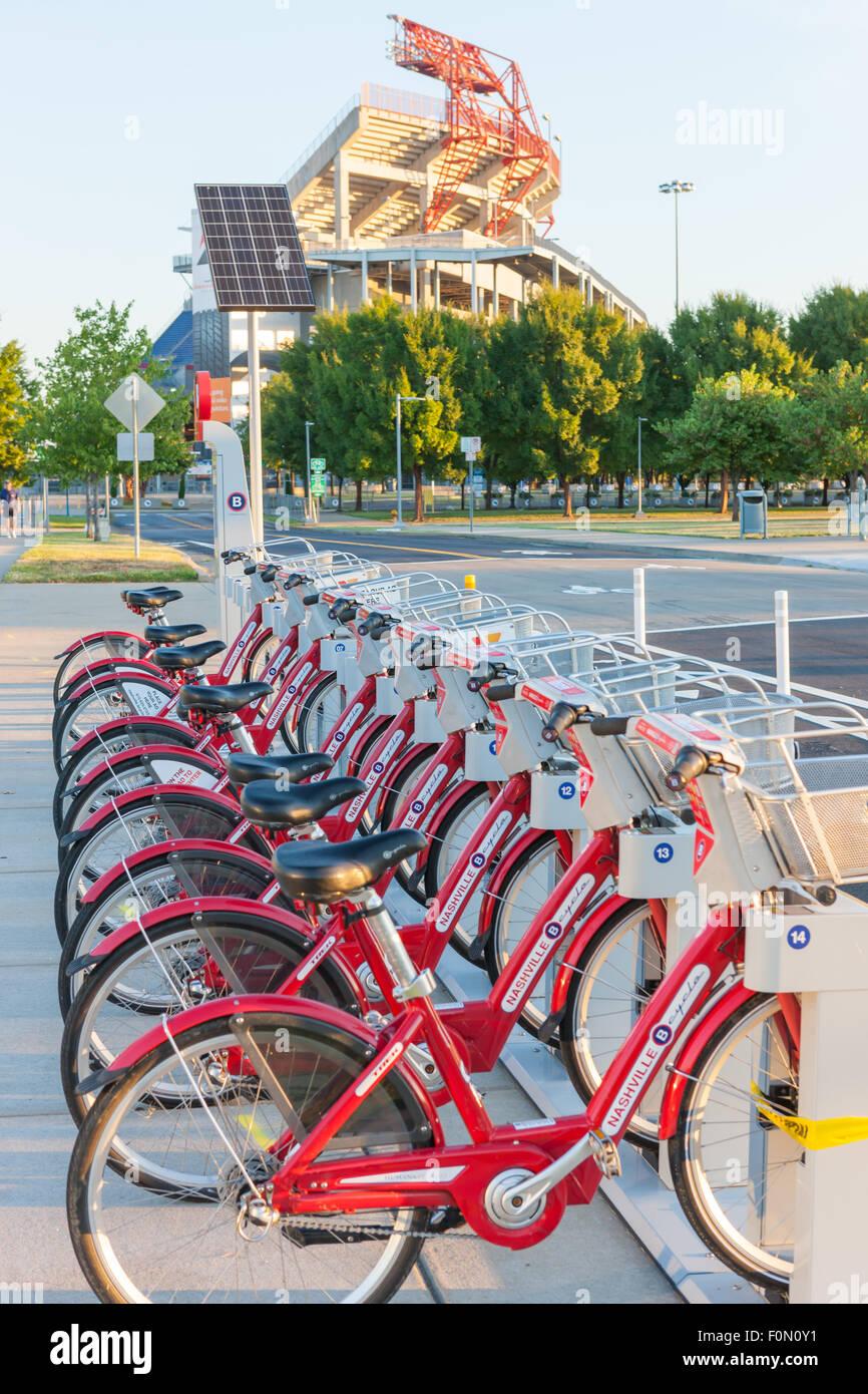 B-cycle bike sharing program bicycles docked at the Cumberland Park B-station near Nissan Stadium in Nashville, - Stock Image