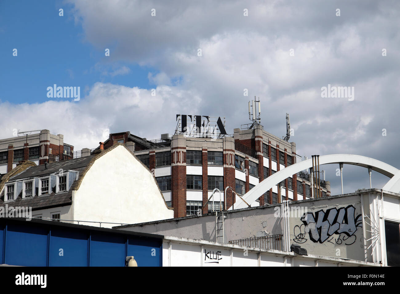 View of the Tea Building sign over roofs in Shoreditch, London UK  KATHY DEWITT - Stock Image
