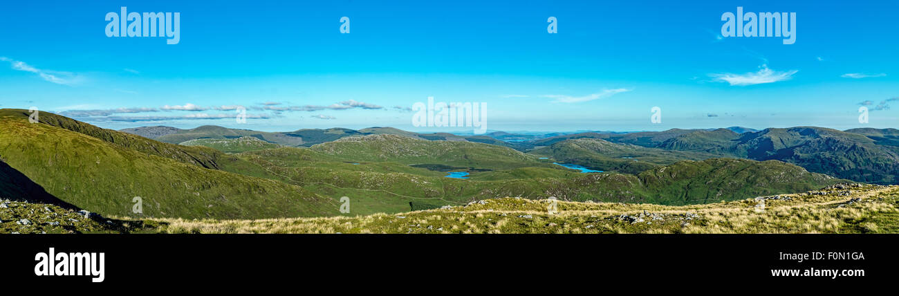 A view from the hike up The Merrick looking across the valleys and hills under a nice August blue sky. - Stock Image