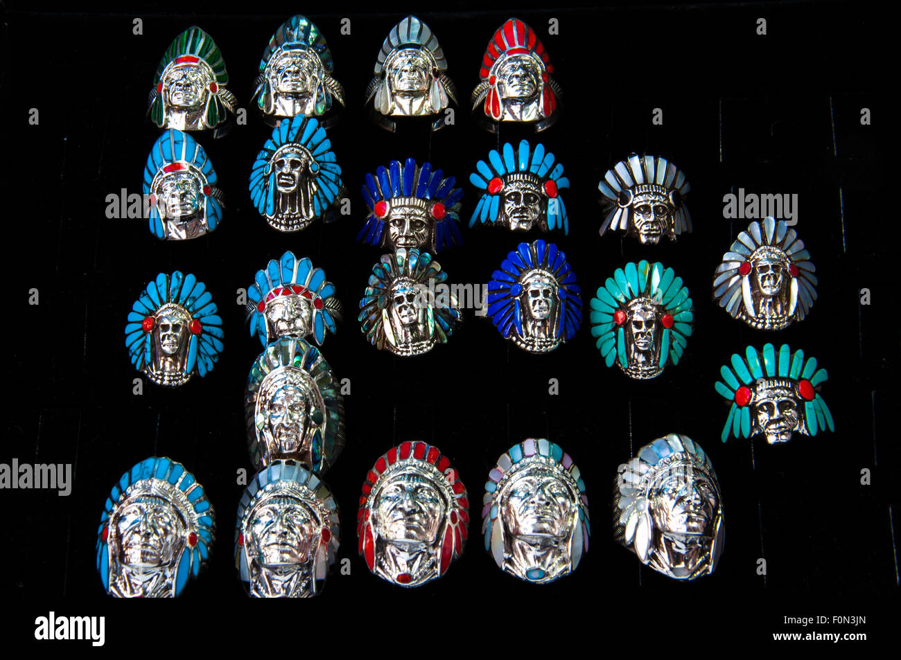 Indian Chief shaped silver rings arranged side by side - Stock Image