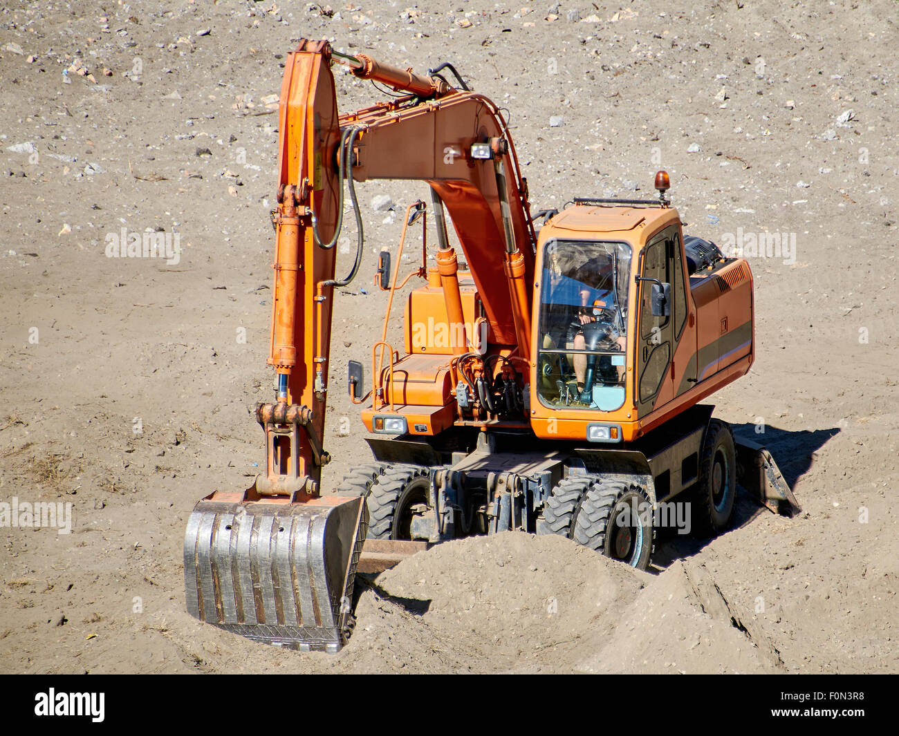 Excavator bulldozer mover in action - Stock Image