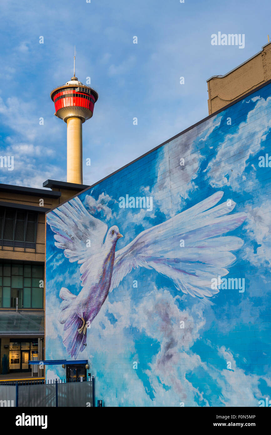 Dove mural and the Calgary Tower, Calgary, Alberta, Canada - Stock Image