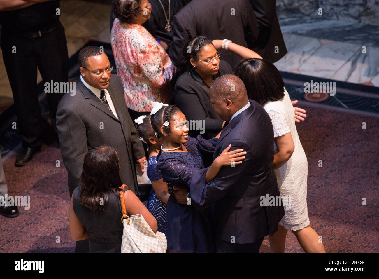 The wife and daughters of slain State Senator Clementa Pinckney embraces mourners during the public viewing in the - Stock Image