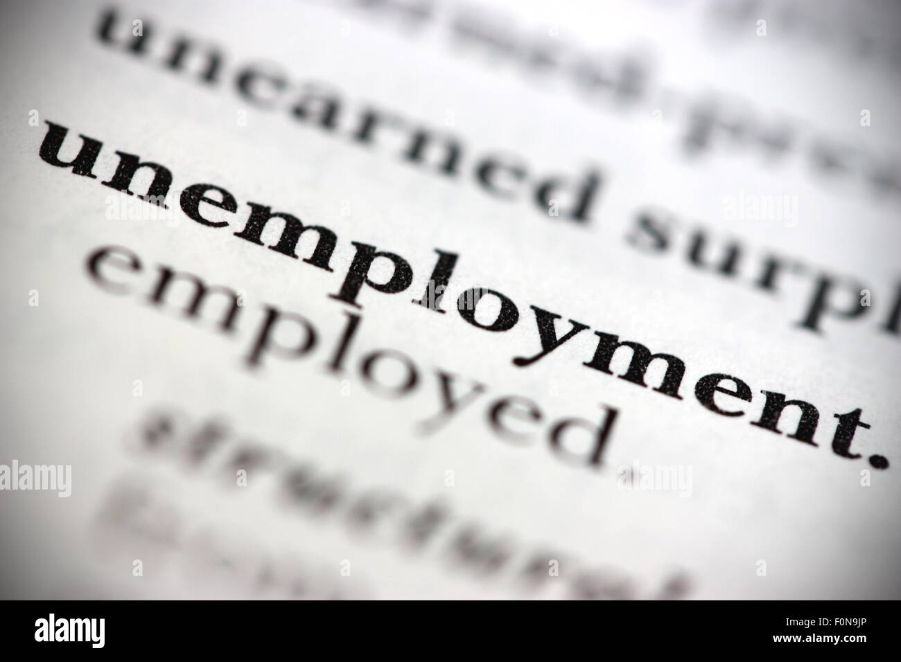 Close up of dictionary word Unemployment - Stock Image