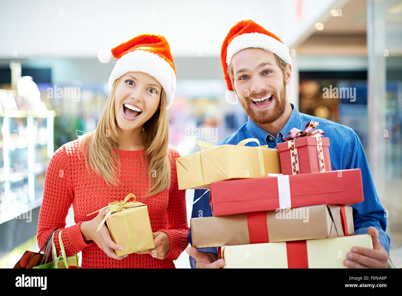 Joyful couple going shopping for Christmas - Stock Image