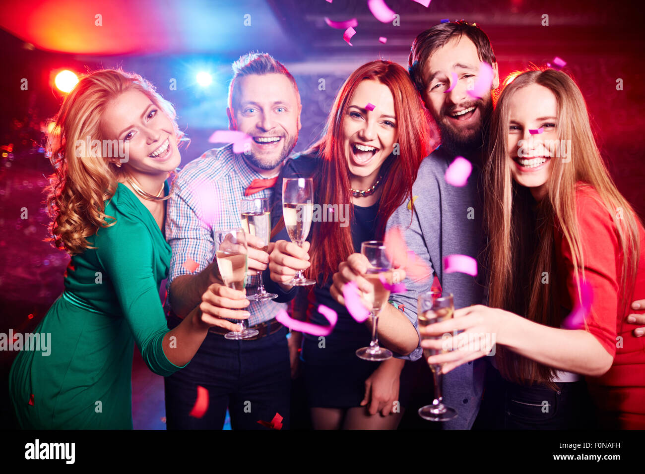 Friends partying at nightclub - Stock Image