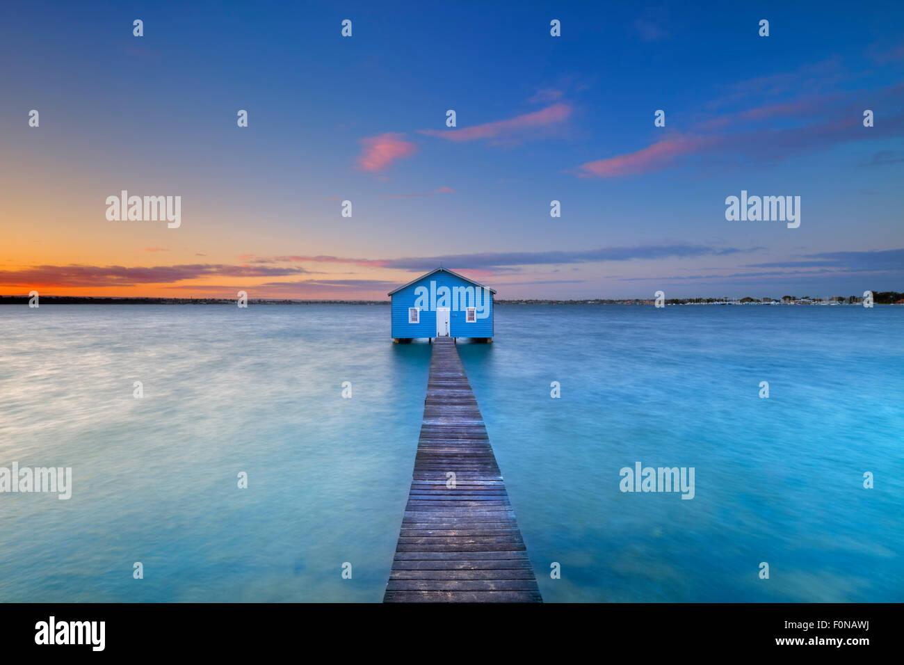 Sunrise over the Matilda Bay boathouse in the Swan River in Perth, Western Australia. - Stock Image
