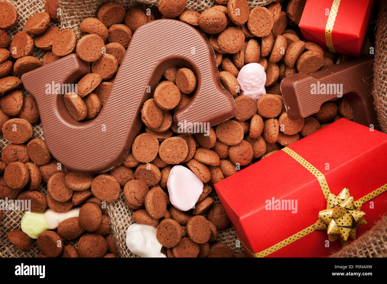 'De zak van Sinterklaas' (St. Nicholas' bag) filled with 'pepernoten', a letter of chocolate - Stock Image